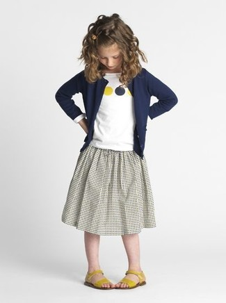 How to Wear Orange Sandals For Girls: Dress your child in a navy cardigan and a grey skirt for a beautiful casual get-up. This look is complemented nicely with orange sandals.