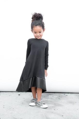 Girls' Looks & Outfits: What To Wear In 2020: Create an enviable style for your little angel by suggesting that she dress in black leather dress. As far as footwear is concerned, suggest that your darling go for a pair of grey sneakers.