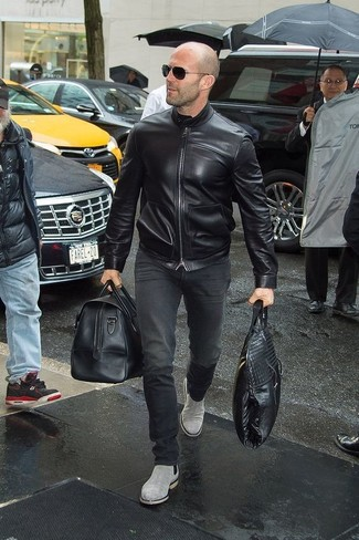 A black leather bomber jacket and black jeans teamed together are a match made in heaven for those dressers who prefer laid-back getups. To give your getup a more elegant vibe, introduce grey suede chelsea boots to this outfit.