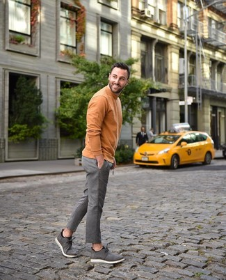 How to wear: grey suede desert boots, grey vertical striped wool dress pants, orange turtleneck