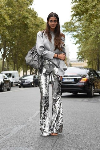 How to Wear a Grey Sweatshirt For Women: This combo of a grey sweatshirt and silver sequin flare pants combines comfort and efficiency and helps you keep it clean yet contemporary.
