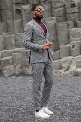 How to wear: grey wool suit, burgundy turtleneck, white leather low top sneakers, black sunglasses