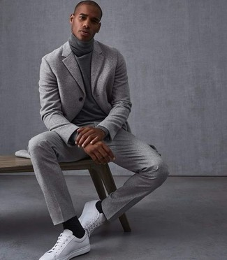 How to wear: grey wool suit, grey turtleneck, white leather low top sneakers, black socks