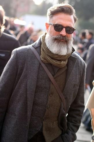 How to wear: grey wool suit, grey wool waistcoat, dark brown leather messenger bag, olive scarf