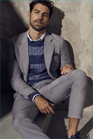 How to wear: grey suit, navy horizontal striped crew-neck sweater, white long sleeve shirt, navy leather low top sneakers