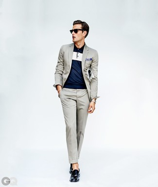 How to wear: grey suit, navy polo, navy leather loafers, blue paisley pocket square
