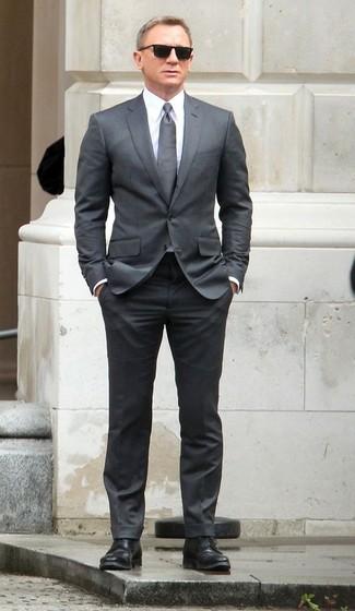 Daniel Craig wearing Grey Suit, White Dress Shirt, Black Leather Derby Shoes, Grey Tie