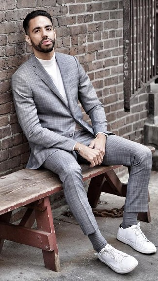 How to wear: grey plaid suit, white turtleneck, white canvas low top sneakers, grey socks