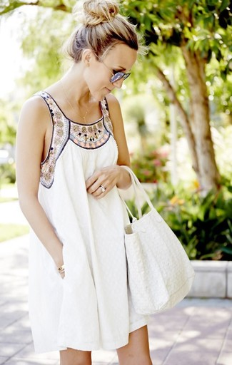 How to wear: grey sunglasses, white canvas tote bag, white embroidered swing dress