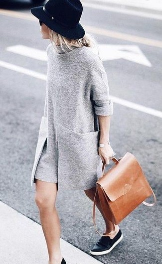 Stylish yet comfortable, this getup features a grey sweater dress. Dress down this ensemble with black leather slip-on sneakers. An ensemble like this makes it easy to embrace unpredictable transitional weather.