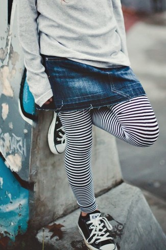 How to wear: grey sweater, navy denim skirt, white and black horizontal striped leggings, black and white sneakers