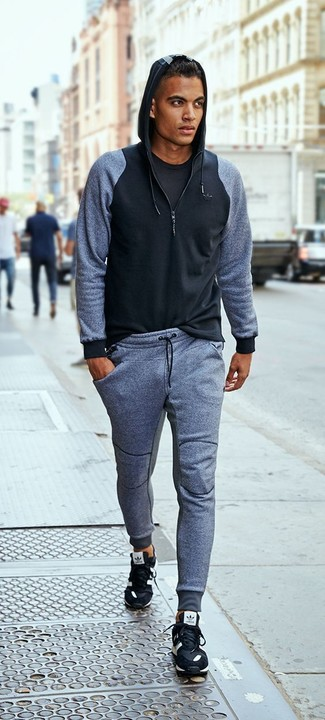 How to wear: black athletic shoes, grey sweatpants, black crew-neck t-shirt, black hoodie