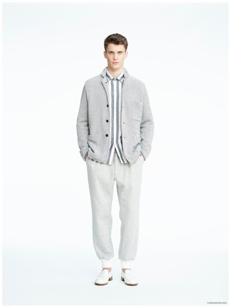 How to wear: white leather loafers, grey sweatpants, grey vertical striped dress shirt, grey shawl cardigan