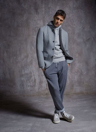 How to wear: grey suede low top sneakers, grey sweatpants, grey hoodie, grey wool shirt jacket