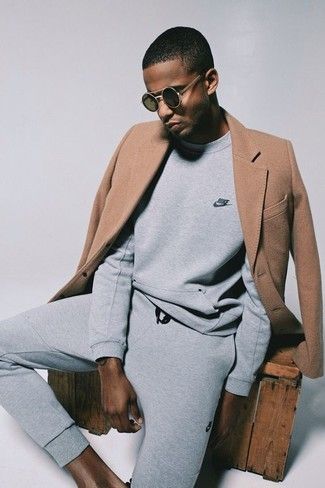How to wear: black sunglasses, grey sweatpants, grey sweatshirt, camel overcoat