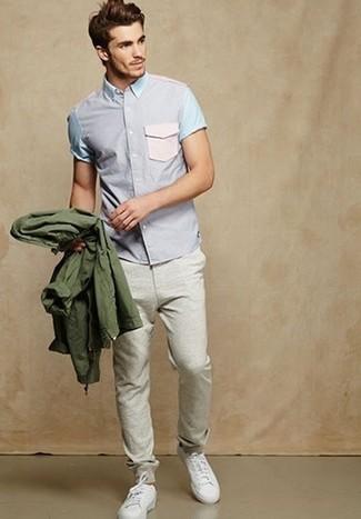 How to wear: white low top sneakers, grey sweatpants, light violet short sleeve shirt, olive windbreaker