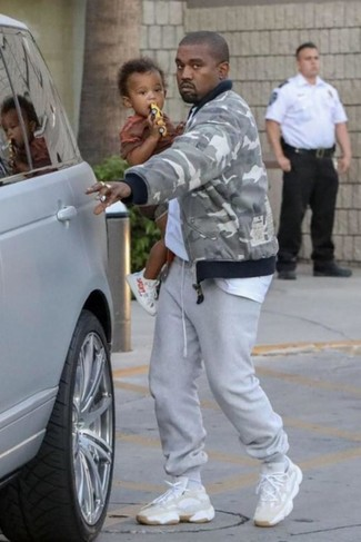 How to wear: beige athletic shoes, grey sweatpants, white crew-neck t-shirt, grey camouflage bomber jacket