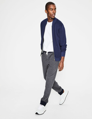 How to wear: white athletic shoes, grey sweatpants, white crew-neck t-shirt, navy bomber jacket