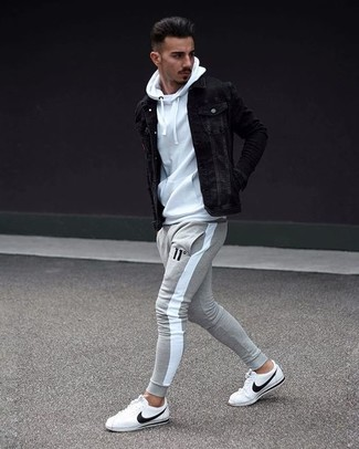 How to wear: white leather low top sneakers, grey sweatpants, white hoodie, black denim jacket