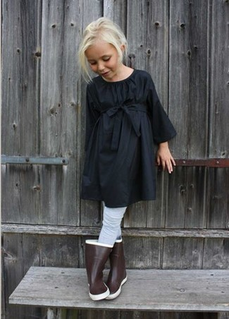 How to wear: grey tights, brown rain boots, black dress