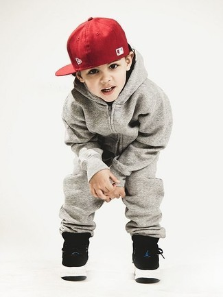 How to wear: grey track suit, black sneakers, red baseball cap