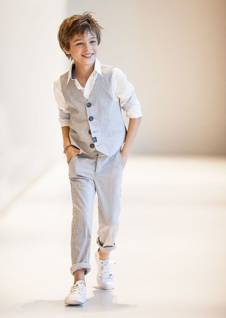 How to wear: white sneakers, grey trousers, white long sleeve shirt, grey waistcoat