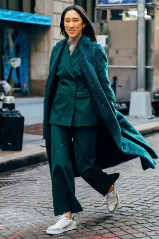 How to wear: white leather low top sneakers, grey wool turtleneck, dark green suit, dark green fur coat