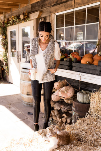 How to wear: grey textured fur vest, white short sleeve sweater, black leather skinny pants, black leather ankle boots