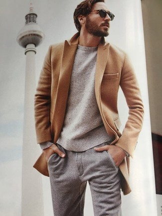 How to wear: grey wool chinos, beige crew-neck sweater, camel overcoat