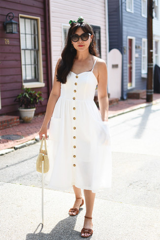How to wear: dark brown sunglasses, beige straw handbag, brown leather flat sandals, white midi dress