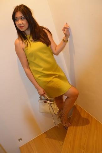 How to wear: gold watch, beige leather handbag, beige suede heeled sandals, mustard shift dress