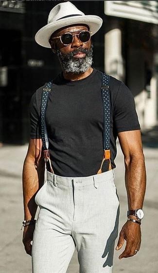 How to wear: black sunglasses, white hat, grey chinos, black crew-neck t-shirt