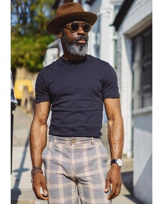 How to wear: black sunglasses, brown wool hat, light blue plaid chinos, navy crew-neck t-shirt