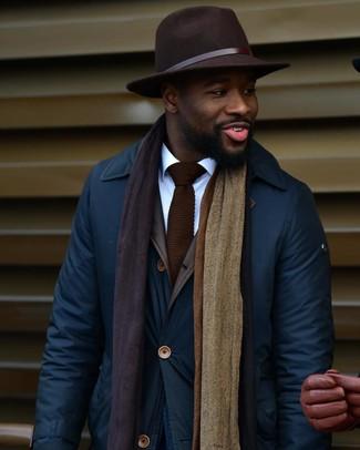 How to wear: dark brown knit tie, dark brown wool hat, white dress shirt, navy barn jacket