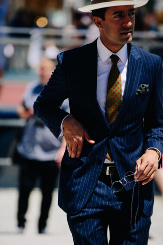 How to wear: dark green print tie, white straw hat, white dress shirt, navy vertical striped suit