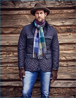 How to wear: multi colored plaid scarf, brown wool hat, blue jeans, navy quilted field jacket