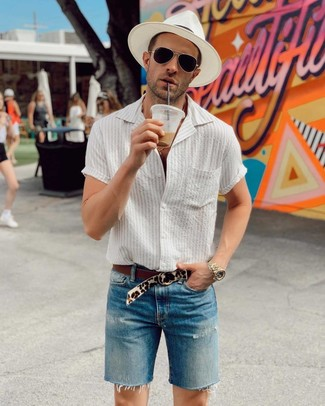 How to wear: beige leopard suede belt, white straw hat, blue denim shorts, white vertical striped short sleeve shirt