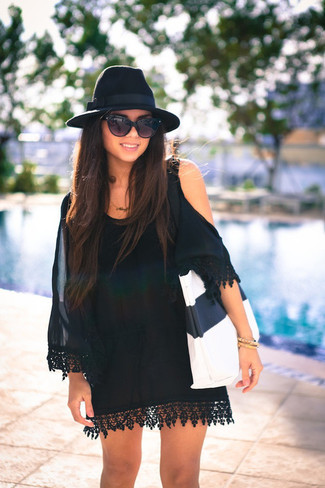 How to wear: black sunglasses, black wool hat, white and black leather tote bag, black silk off shoulder dress