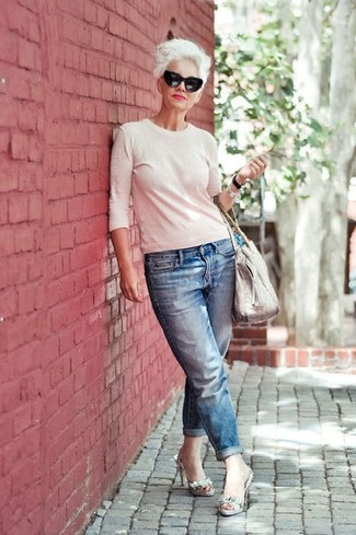 How to Wear a White Crew-neck Sweater For Women: You'll be amazed at how easy it is to get dressed this way. Just a white crew-neck sweater and blue boyfriend jeans. Why not take a classier approach with footwear and introduce a pair of grey snake leather heeled sandals to the equation?