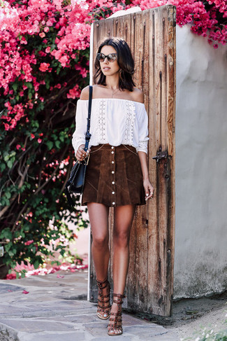 How to Wear a Black Leather Crossbody Bag Casually: If you're hunting for a casual and at the same time chic getup, try pairing a white embroidered off shoulder top with a black leather crossbody bag. Why not complete this ensemble with dark brown studded leather heeled sandals for a dash of class?