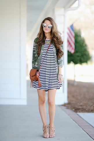 How to wear: brown leather crossbody bag, beige suede heeled sandals, white and black horizontal striped casual dress, olive camouflage military jacket