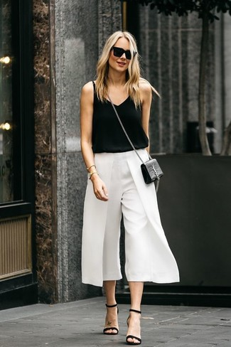 How to wear: black leather crossbody bag, black leather heeled sandals, white culottes, black tank