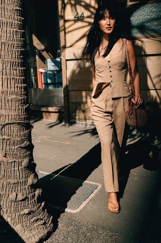 How to wear: brown straw crossbody bag, tan leather heeled sandals, khaki dress pants, tan bustier top