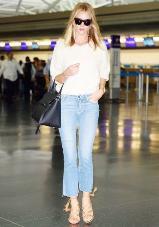 How to wear: black leather satchel bag, tan suede heeled sandals, light blue flare jeans, white short sleeve sweater