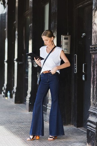 How to wear: navy leather crossbody bag, black leather heeled sandals, navy flare jeans, white tank