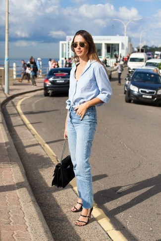 How to wear: black leather satchel bag, black leather heeled sandals, light blue jeans, light blue dress shirt