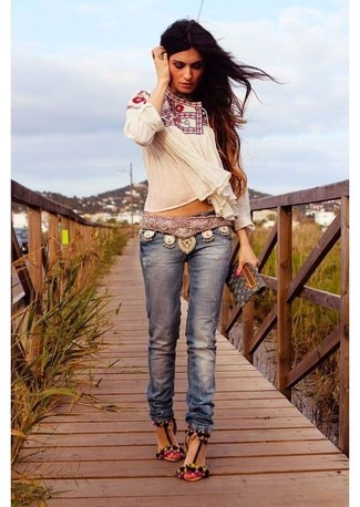 How to wear: black print leather clutch, multi colored suede heeled sandals, blue jeans, white embroidered peasant blouse