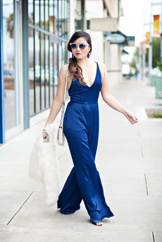 How to wear: white quilted leather crossbody bag, blue satin heeled sandals, blue jumpsuit, white fur jacket