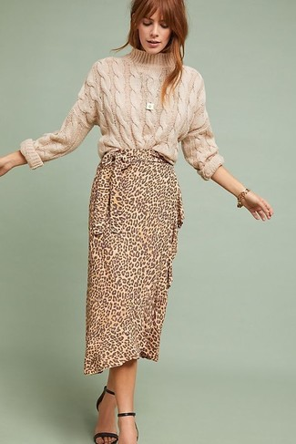 How to Wear a Beige Cable Sweater For Women: A beige cable sweater and a tan leopard midi skirt are a cool outfit formula to have in your sartorial collection. Finishing with a pair of black leather heeled sandals is the most effective way to bring some extra fanciness to this look.