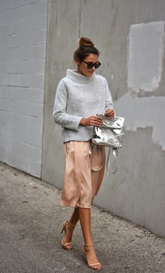 How to wear: grey leather backpack, beige leather heeled sandals, pink silk midi skirt, grey cowl-neck sweater